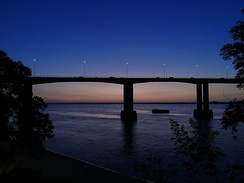 This is a picture of the Belgrano Bridge during sunset.