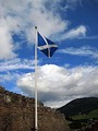 The Saltire, the national flag of Scotland: A white (argent) saltire on a blue (azure) field.