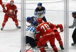 Skaters from the Finnish and Belorussian men's ice hockey teams shortly after a face-off during the 2016 IIHF World Championship. The IIHF is an annual national team tournament.