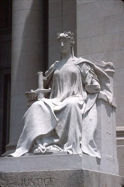 Lady Justice (Latin: Justicia), symbol of the judiciary.[27][28] Statue at Shelby County Courthouse, Memphis, Tennessee