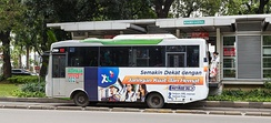 Indonesian language used on a bus advertisement