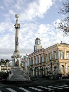 Saint-Denis's former city hall and the Column of Victory.