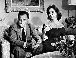CBS paid Mike Todd for the rights to cover the anniversary celebration as a television special.[20] Todd and his wife Elizabeth Taylor are seen here at home in a film clip which was used for the television special.