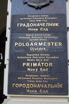 Multi-lingual sign outside the mayor's office in Novi Sad, written in the four official languages of the city: Serbian, Hungarian, Slovak, and Pannonian Rusyn