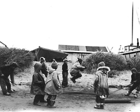 Nunivak Cup'ig children playing jump-rope (qawaliqtar in Cup'ig), 1940 or 1941.