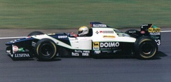 Martini driving a Minardi M195 at the 1995 British Grand Prix