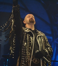Rob Halford of Judas Priest wearing studded leather jacket
