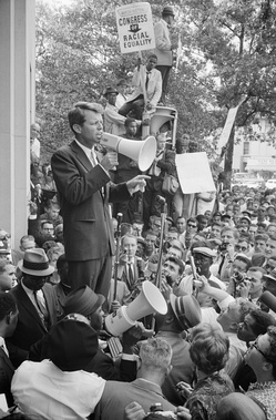 Robert Kennedy speaking to civil rights demonstrators in front of the Justice Department on June 14