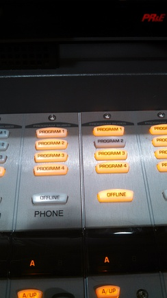 Programming channels on a radio sound board.