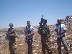 IDF soldiers and Israeli settlers, 2009