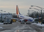 December 8: Southwest Airlines Flight 1248 overshoots the runway at Chicago Midway Airport