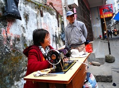 A roadside tailor in Haikou City, Hainan Province, China