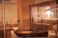 Scale model of HMS Breda at the Thomson Collection of Ship Models. A scale model of HMS Hogue may be seen in the background.