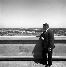 White House Photographer, Cecil Stoughton, on the roof of an unidentified building.jpg