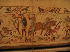 "The Bayeux Tapestry, depicting the death of King Harold II, October 14, 1066. At left can be seen his ""Dragon Standard"""