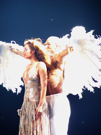 "Knowles performing ""Flaws and All"" in Barcelona. During the performance she was embraced by a male dancer dressed as an angel."