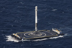 A landed Falcon 9 first stage on Of Course I Still Love You