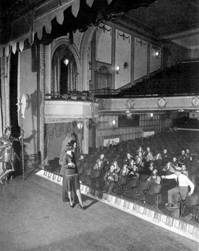Constance Carpenter and William Gaxton, principals of the original Broadway production of Rodgers and Hart's A Connecticut Yankee, on stage at the Vanderbilt Theatre during a mid-run rehearsal of the hit musical (1928). Producer Lew Fields is seen at right, in shirtsleeves.