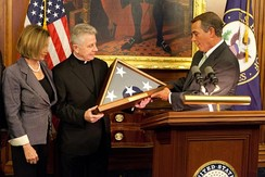 House Speaker John Boehner and Minority Leader Nancy Pelosi present a flag flown over the U.S. Capitol to Fr. Daniel Coughlin in recognition for his 11 years of service as Chaplain of the United States House of Representatives, April 2011