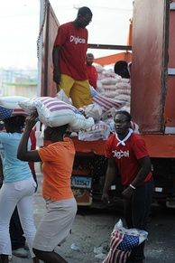 Volunteers from Digicel distributed several tons of food to Haitian citizens in Port-au-Prince, in a distribution sponsored by the Agency for Technical Cooperation and Development following the devastating 2010 Haiti earthquake.