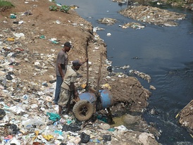 Siltation caused by fecal sludge collected from pit latrines and dumped into a river at the Korogocho slum in Nairobi, Kenya.