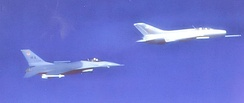 USAF Fighter Weapons School F-16 flying with a Constant Peg MiG-21 over the Nevada desert, about 1986