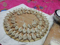In north China, folded jiaozi are placed on bi (箅), in case the stuffing will make the shape saggy. Bi is made by dried sorghum stems, and it also gives Jiaozi a mark at the bottom.