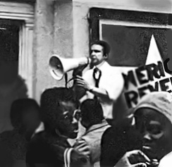 "Keith Fowler, outside American Revels Company at the Empire Theater, greeting neighbors at a free performance of ""I Have a Dream,"" 1979"