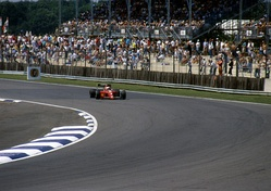 Former Formula One world champion Nigel Mansell driving at Silverstone in 1990. The circuit hosted the first ever Formula One race in 1950