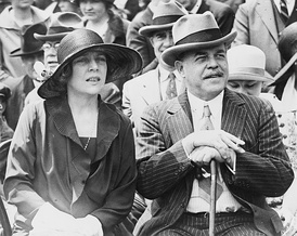 Alice Roosevelt Longworth and her husband, House Speaker and Ohio Congressman Nicholas Longworth on the steps of the US Capitol in 1926