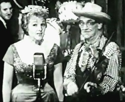 "Jo Stafford as Cinderella G. Stump with Red Ingle performing their 1947 hit, ""Tim-Tay-Shun"", on Startime in 1960"
