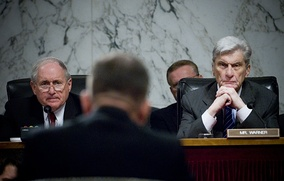 The Senate Armed Services Committee chairman Carl Levin and ranking member John Warner in 2007 hearing opening statements during a confirmation hearing for a position in the Department of Defense.