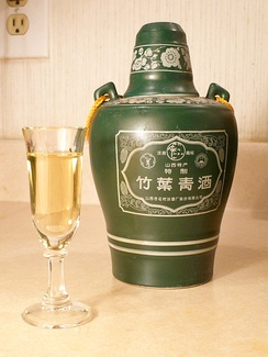 A glass and bottle of Zhuyeqing jiu from Shanxi province