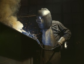 Welder making boilers for a ship, Combustion Engineering Company. Chattanooga, Tennessee, June 1942. Despite their name, blue-collar workers don't always or typically wear blue shirts.