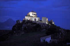 The Calatubo Castle by night.