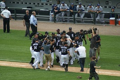 Teammates celebrate Mark Buehrle's perfect game, July 23, 2009