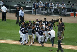 Teammates celebrate Buehrle's perfect game on July 23, 2009