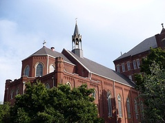 "The Duquesne University chapel adjoins the ""Old Main"" administration building."