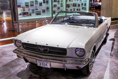 """1964½"" Mustang convertible Serial #1, sold to Stanley Tucker who was given the one millionth Mustang in exchange for his historic car[22]"