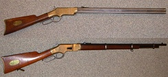 A Henry Rifle and a Winchester Mod 1866 Rifle. These repeater rifles were capable of higher rates of fire than the Springfield Trapdoor.