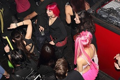 People dance at an industrial music event in a nightclub (Athens, 2012)