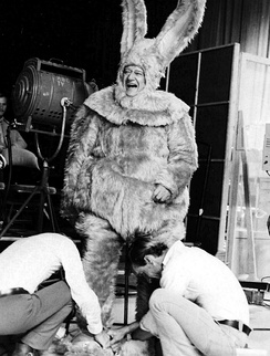 John Wayne being fitted for a giant bunny costume, 1972