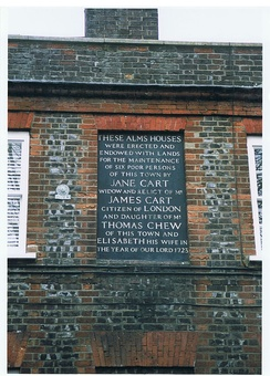 Monumental inscription on the Chew almshouses, commemorating their endowment in 1723.
