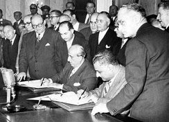 Egyptian president Gamal Abdel Nasser (seated right) and Syrian president Shukri al-Quwatli sign the accord to form the United Arab Republic in 1958. The short-lived political union briefly represented both states and was used as the name of Egypt following Syria's withdrawal in 1961.