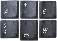Keycaps featuring Univers from a pre-2003 PowerBook G4