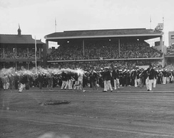 Ron Clarke carrying the Olympic Torch through the MCG at the 1956 Olympic Games' opening ceremony.