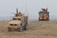 U.S. and Turkish forces conduct joint patrols on the outskirts of Manbij, Syria, 8 November 2018