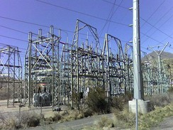A transmission substation decreases the voltage of incoming electricity, allowing it to connect from long-distance high voltage transmission, to local lower voltage distribution. It also reroutes power to other transmission lines that serve local markets. This is the PacifiCorp Hale Substation, Orem, Utah, USA