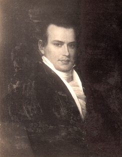 Dark-haired man with white tie and black coat