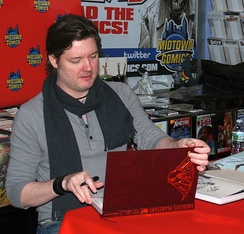 Artist John Cassaday signing copies of the hardcover collection during an appearance at Midtown Comics